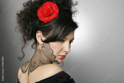 Woman with fashion hairstyle and body painting