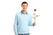 Young smiling man holding a rose flower