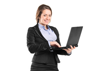 Portrait of a smiling young businesswoman working on a laptop