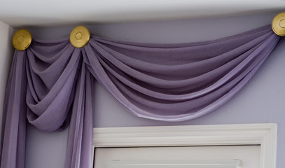 Valance drapery treatment with high ceiling above doorway