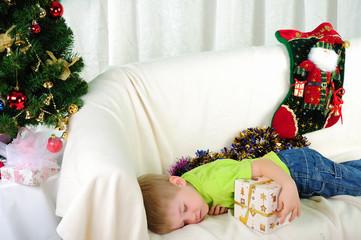 little boy fell a sleep on the couch
