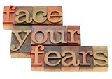 face your fears phrase in letterpress type poster