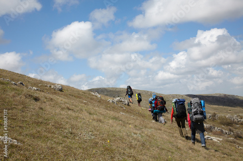 Group of backpackers walking on a hill