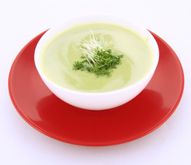 Pea and mozzarella soup decorated with some cress
