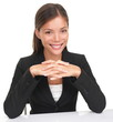 Businesswoman sitting at table smiling