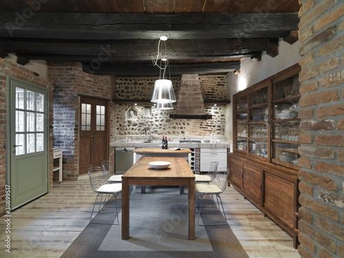 cucina con mobili moderni con muri di pietra