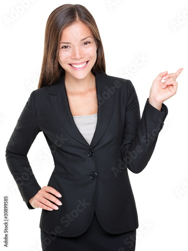 Businesswoman in suit pointing