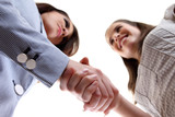 business women shaking hands