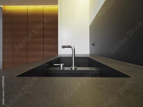 Lavello in marmo nero con rubinetto acciaio in cucina - Lavello cucina nero ...