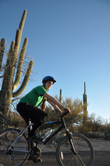 Girl biking in saguaro national park arizona