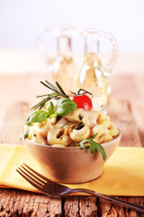 Tortellini with pesto and sauce