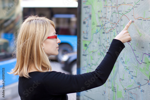 Woman looking on the metro map board
