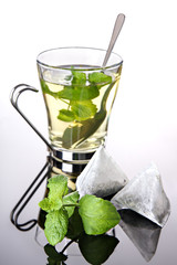 Herbal tea with pyramid teabags and mint