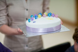 Woman serving birthday cake