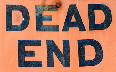 A Dirty, Grungy, Orange Dead End Sign