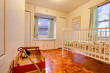 Baby room with crib and window seat