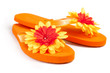 orange flip-flops with flowers