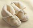 Pair of baby booties on soft woolen fabric