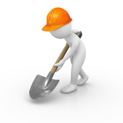 Construction worker digging the ground with a shovel