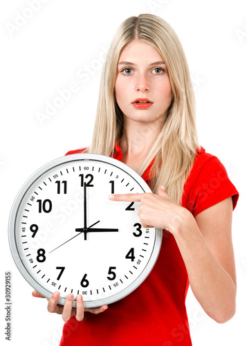 Young businesswoman with a clock