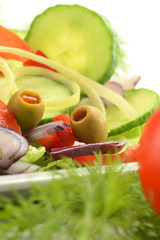 Composition with vegetable salad with olives.