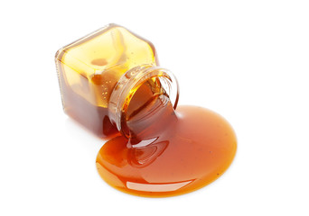 Honey spill from a glass jar