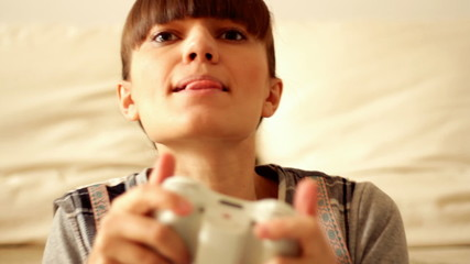 Young exciting woman playing videogames, steadicam shot