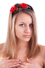 Young pretty woman with flower in hair