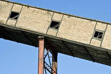 Abandoned Factory Building And Chimney