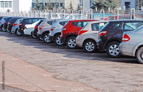 Leinwanddruck Bild A row of parcked cars