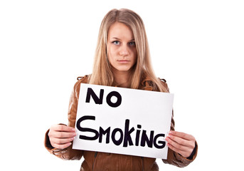 Girl holding a poster that says no smoking