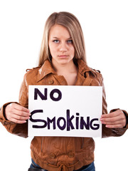 Young girl is holding no smoking sign