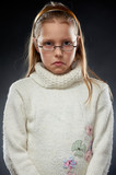 Portrait of a displeased little girl in eyeglasses poster