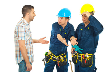 Workers giving explanations to a client