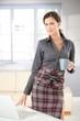 Attractive woman standing drinking tea