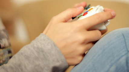 Female hands playing videogames
