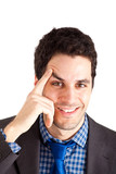 Smiling businessman with finger on his eyebrow poster