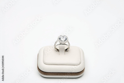 Platinum ring with 5 carat centre diamond surrounded by full cut 0.80 carat diamonds