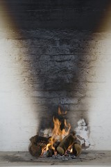 Flames burn from firewood and sunlight