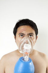 Breathing, A man using resuscitator to cure suffocating