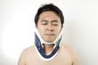 Neck pain, A man using hard collar to kill pain.
