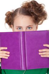 Girl peep behing open book