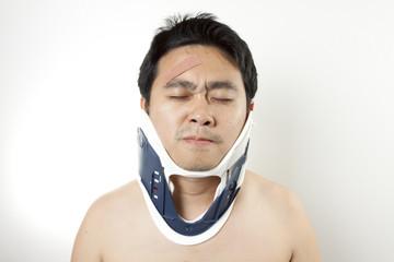 Neck pain, A man using hard collar to kill pain.