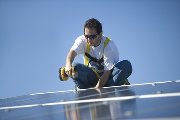 A man working on solar panelling