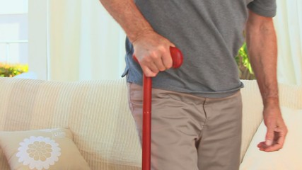 Retired man using a walking stick