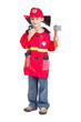 cute little child fireman holding walkie talkie and axe