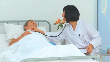 Nurse using a stethoscope
