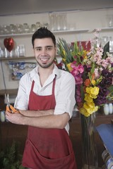 Florist stands with flower arrangement