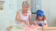 Grandmother and her grand daughter cooking together
