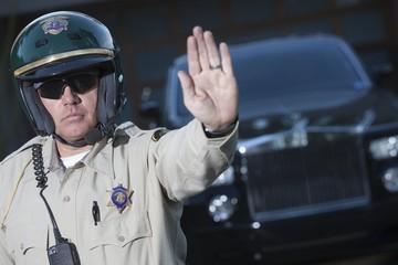 Patrol officer stops traffic, police escort